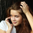 Young woman calling by phone — Stock Photo #15853457