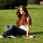 Portrait of young beautiful woman reading magazine — Stock Photo #15853469