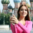 Stock Photo: Young womphotographed attractions in Moscow