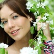 Portrait of beautiful woman in spring blossom - Stockfoto