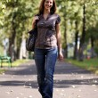 Beautiful young woman walking on the street — Stock Photo