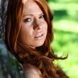 Stock Photo: Portrait of red-haired beautiful young woman