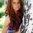 Portrait of red-haired beautiful young woman — Stok fotoğraf