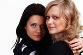 Couple women - blonde against the brunette — Foto Stock