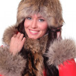 Portrait of a beautiful happy woman wearing fur  — Stock Photo