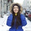 Portrait of a young woman on the background of a winter city — Stock Photo