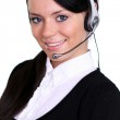 Portrait of a confident young female customer service agent with headset — Stock Photo #19269305