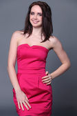 Happy young woman in red dress — Stock Photo