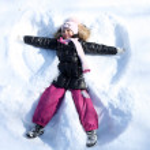 Beautiful little girl in winter park — Stock Photo