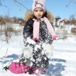 Beautiful little girl in winter park — Stock Photo