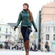 Walking woman in autumn Moscow street - Stockfoto