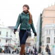 Walking woman in autumn Moscow street - Stok fotoğraf