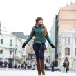 Walking woman in autumn Moscow street - Stock Photo