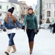 Happy young couple women in winter street - Stock Photo