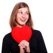 Portrait of a attractive young woman holding a red heart — Stock Photo