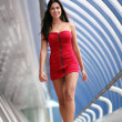 Beautiful walking woman in red dress - Stock Photo