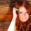 Stock Photo: Portrait of beautiful red-haired girl