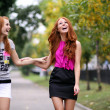 Happy two young women in autumn city — Foto de Stock