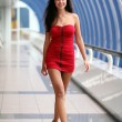 Beautiful walking woman in red dress — Stock Photo