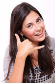 Beautiful woman making a call me gesture — Stock Photo