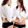 Stock Photo: Couple women in white sexy shirt