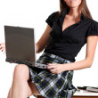 Happy young woman using a laptop — Stock Photo