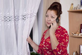 Portrait of an elderly woman calling by phone — Stock Photo