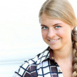 Young beautiful womwith long blonde queue — Stock Photo #24167521