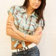Young woman in blue jeans and cell shirt - Stock Photo