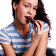 Young beautiful woman eating Cake - Stock Photo