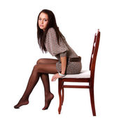Brunette woman in elegant dress sit on chair — Stock Photo