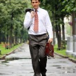 Cheerful young businessman walking on the street — Stock Photo #24367747