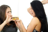Two girls divide one sandwich — Stock Photo