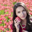 Beautiful young woman with tulips - Stock Photo