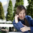 Young woman calling by phone — Stock Photo #26811291