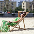 Young beautiful womrelaxing lying on sun lounger — Stock Photo #26840767