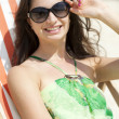 Stock Photo: Young beautiful woman relaxing lying on a sun lounger