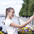 Stock Photo: Happy young woman taking pictures on your phone