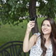 Happy young woman taking pictures on your phone — Stock Photo
