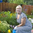 Mature woman in the garden — Foto de Stock
