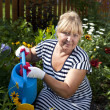 Stock Photo: Mature woman in the garden