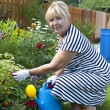Mature woman in the garden — Stockfoto