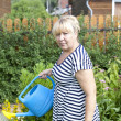 Mature woman in the garden — Stock fotografie