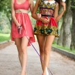 Two cheerful girls in the street — Stock Photo