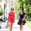 Two young women walking in the summer city — Stock Photo #28549951