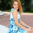 Young happy woman in summer dress — Stock Photo