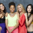 Ethnic four women face — Stock Photo