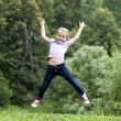 Happy little girl jumping in summer day — Stock Photo #29326049