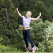 Happy little girl jumping in summer day — Stock Photo #29326073