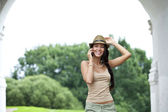 Happy woman talking on cell phone — Stockfoto